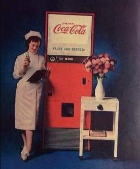 nurse_leaning_on_coca-cola_machine_drinking_Coke.jpeg