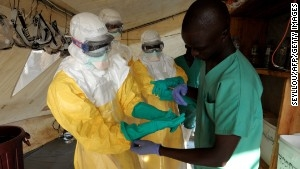 140401172138-ebola-health-specialists-story-body.jpg